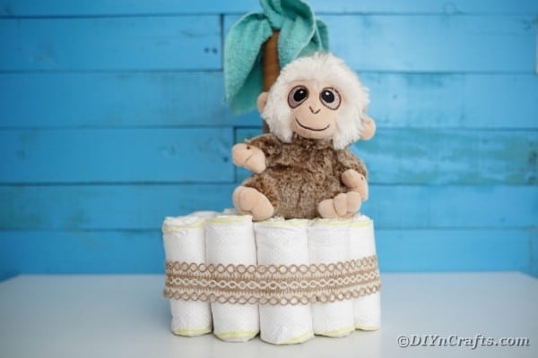 Palm tree diaper cake by blue wall