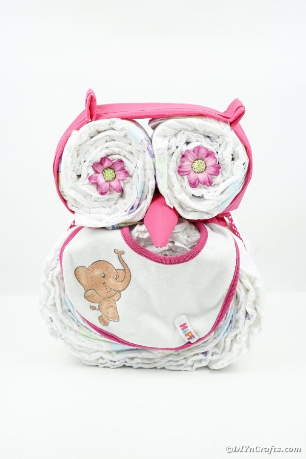 Diaper cake owl on white surface