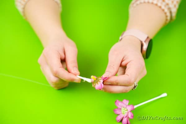 Gluing flowers on qtips