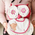 Woman holding diaper cake owl