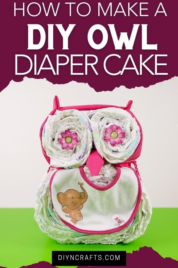 Owl diaper cake on green table