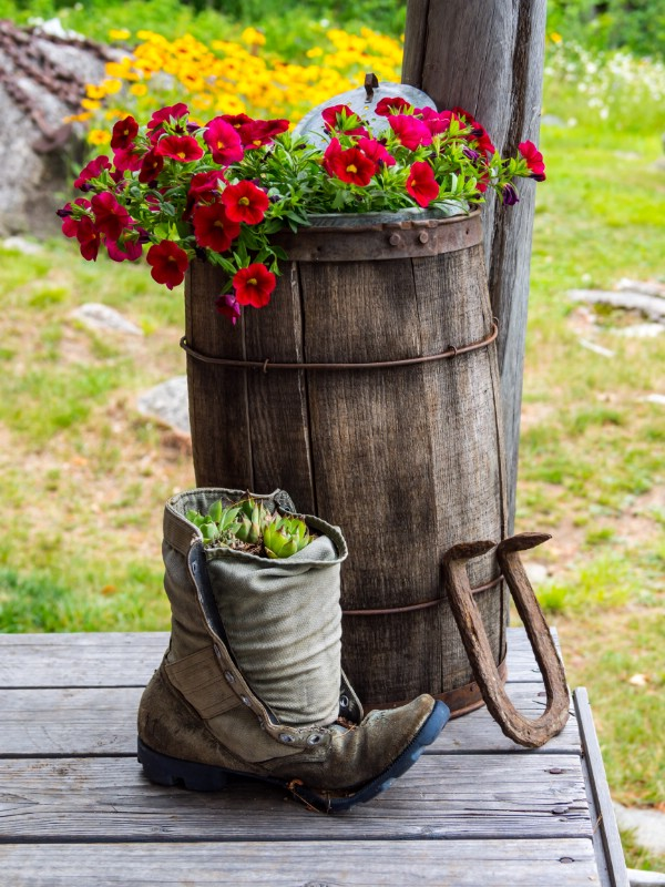 Whiskey barrel and boot with flowers