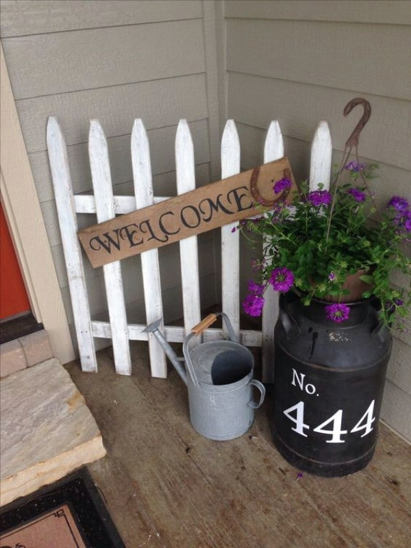 White picket fence welcome sign