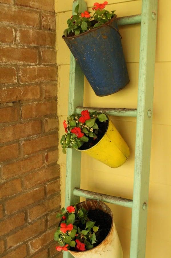 Green ladder with bucket planters