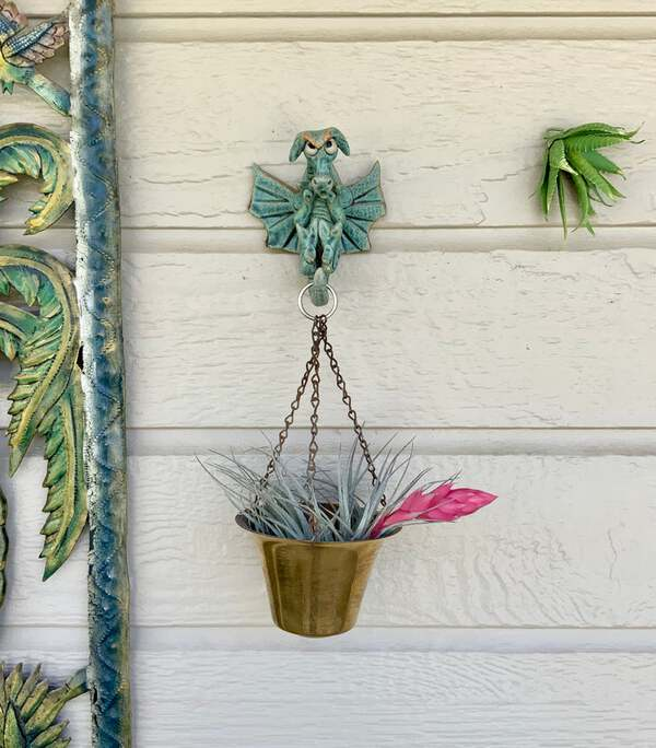 Gargoyle plant hook