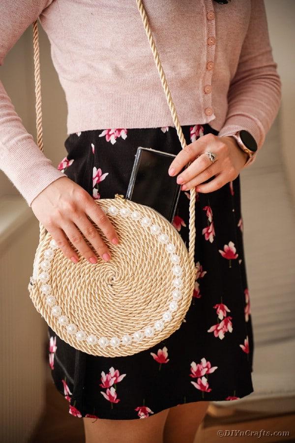 Woman wearing rope purse