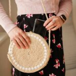 Woman holding rope purse