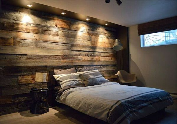 Wood bedroom wall with recessed lighting