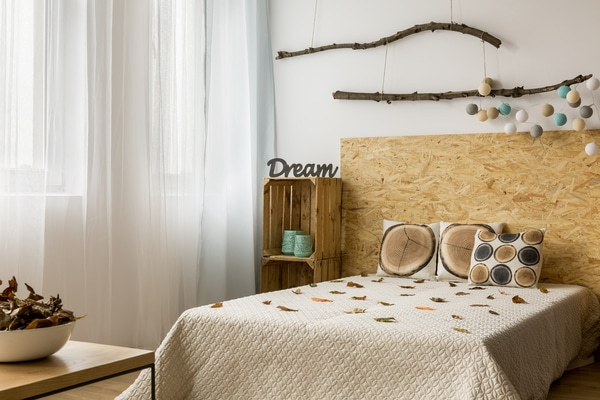 Branches hanging above the bed