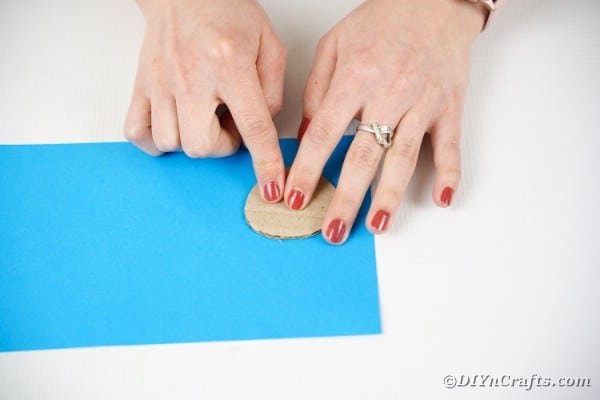 Tracing circle onto blue paper