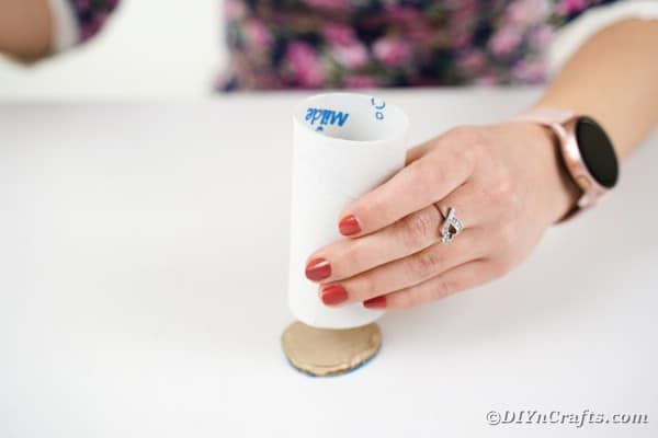 Gluing cardboard to toilet paper roll