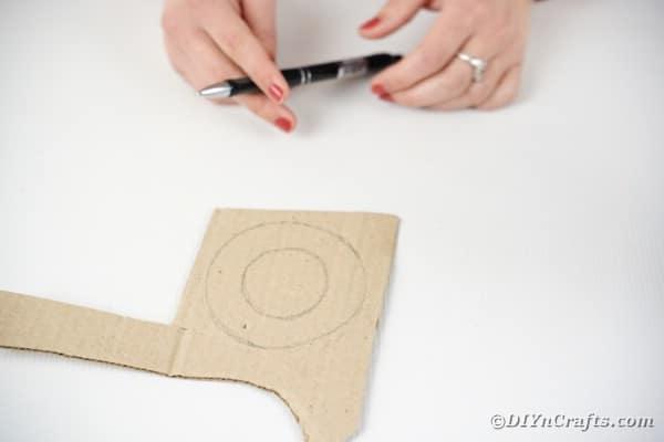 Tracing circle on cardboard