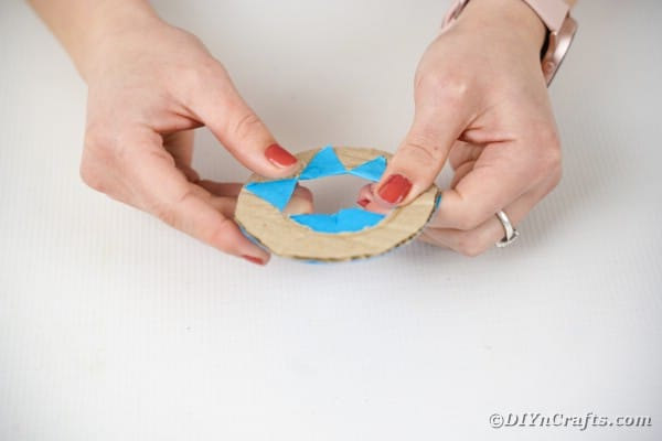 Coating cardboard ring with paper