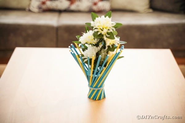 Colorful stick vase on wood table