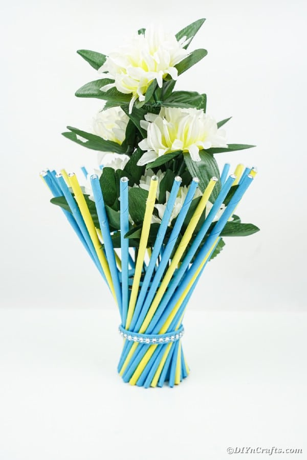 Blue and yellow vase on white counter