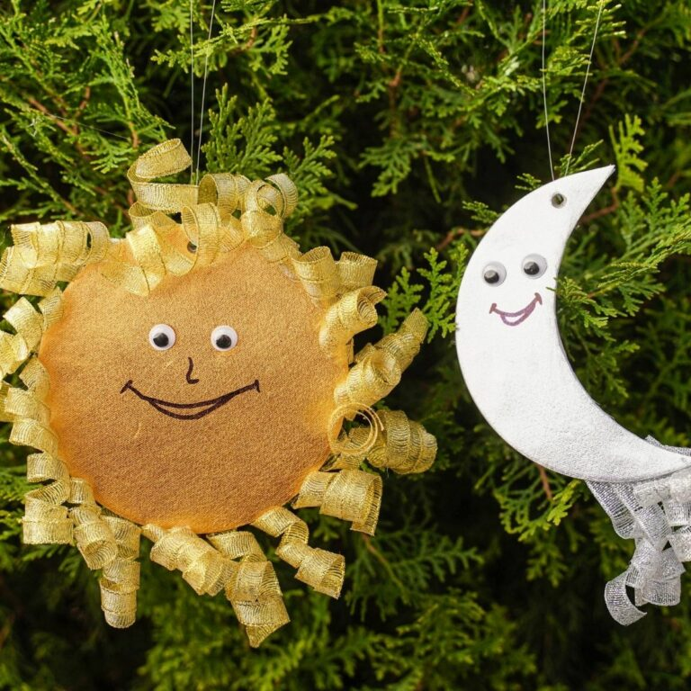 Sun and moon on green cedar bush