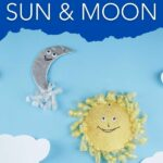 Sun and moon decoration on blue wall with clouds