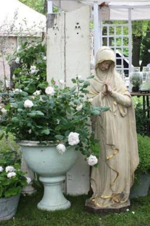 Concrete statue in garden