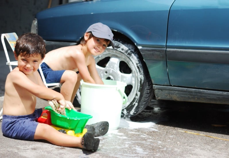 Kids cleaning the car.