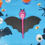 Spoon bats on blue background