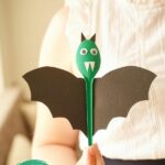 Woman holding spoon bat