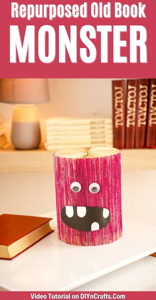 Monster on table by book