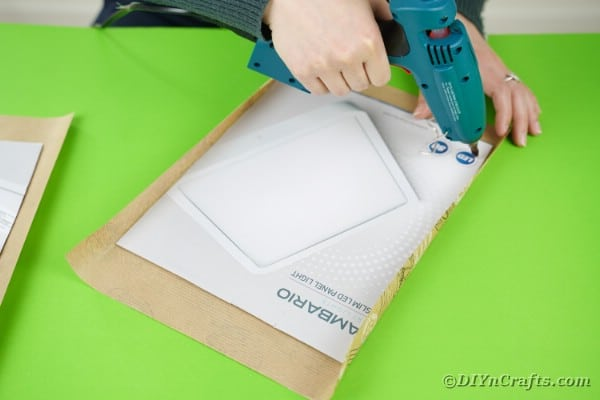 Gluing cardboard to wrapping paper