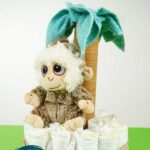 Palm tree diaper cake on green surface