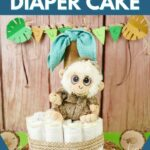 Diaper cake in front of wood wall