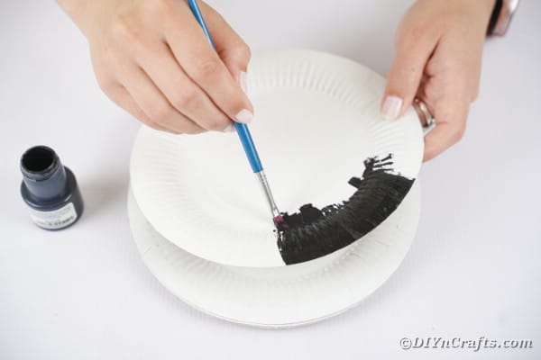 Painting a paper plate black