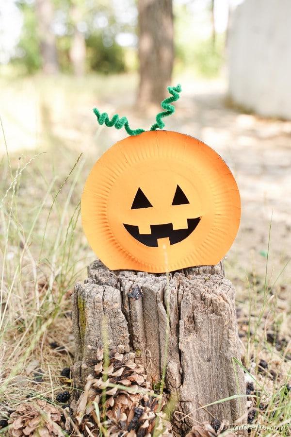 Pumpkin craft on stump