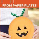 Woman holding paper plate pumpkin