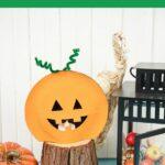 Paper plate pumpkin by halloween decor