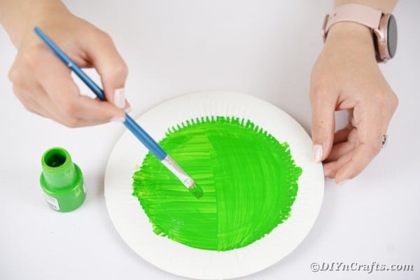Painting paper plate green