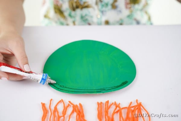 Adding glue to painted plate