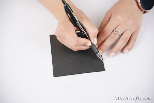 Drawing bat wing on black paper