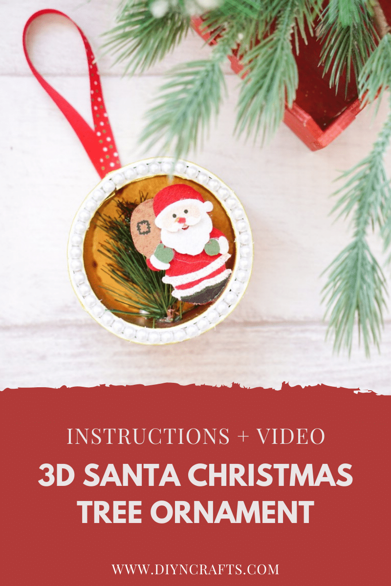 Santa 3D ornament on table with tree