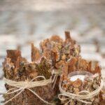 Tree bark lanterns on cobblestone