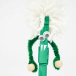 Green clothespin monster on white surface