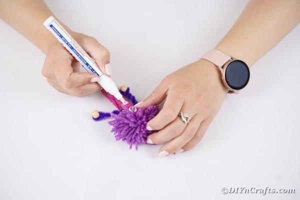 Drawing teeth onto clothespin
