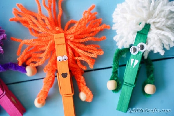 Clothespin monsters on blue boards