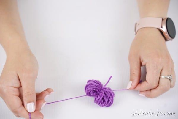 Tying yarn ball