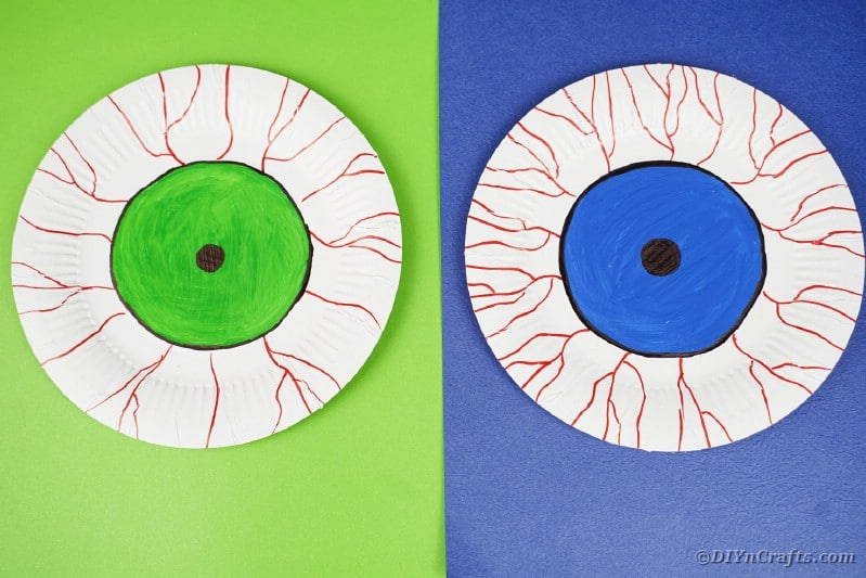 Paper plate bloodshot eyes on colored paper