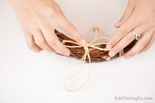 Gluing bow onto grapevine wreath