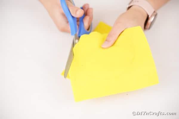 Cutting yellow felt