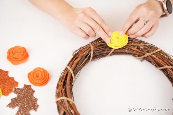 Gluing Flower onto grapevine wreath