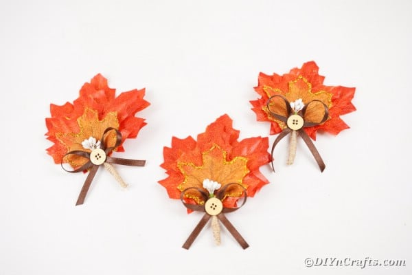 Fall leaf boutonniers on white table