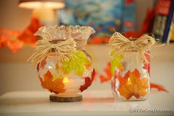 Glass leaf fall lantern on table