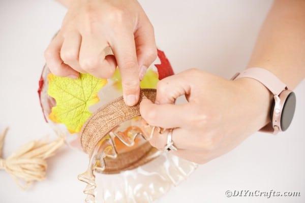 Adding ribbon around edge of jar