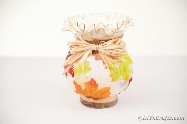 Adding raffia bow to front of jar